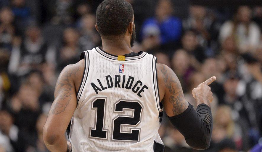 San Antonio Spurs forward LaMarcus Aldridge celebrates a basket during the first half of an NBA basketball game against the Phoenix Suns, Wednesday, Dec. 30, 2015, in San Antonio. (AP Photo/Darren Abate)