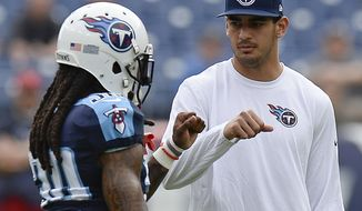 "FILE - In this Sunday, Dec. 27, 2015, file photo, injured Tennessee Titans quarterback Marcus Mariota, right, greets cornerback B. W. Webb (38) before an NFL football game against the Houston Texan in Nashville, Tenn. Mariota's season is over. Titans interim head coach Mike Mularkey says it's ""not worth the risk"" of playing the rookie in their season finale Sunday at Indianapolis.  (AP Photo/Mark Zaleski, File)"