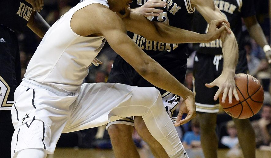 Vanderbilt forward Jeff Roberson, left, battles for the ball with Western Michigan guard Taylor Perry during the first half of an NCAA college basketball game Wednesday, Dec. 30, 2015, in Nashville, Tenn. (Mark Zaleski/The Tennessean via AP)