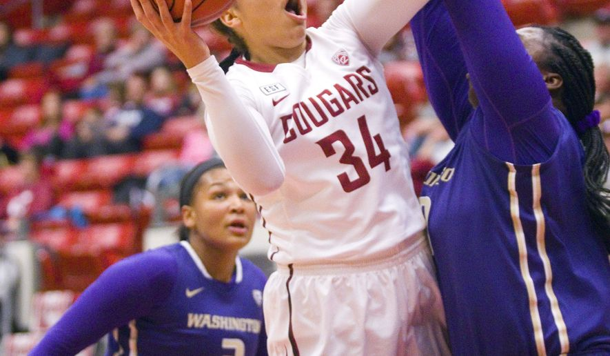 Washington State forward Mariah Cooks, center, shoots under pressure from Washington's Talia Walton, left, and Chantel Osahor in the first half of an NCAA college basketball game in Pullman, Wash., Tuesday, Dec. 29, 2015. (Geoff Crimmins/The Moscow-Pullman Daily News via AP) MANDATORY CREDIT