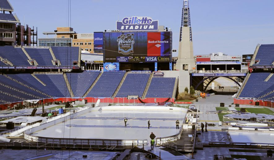 Workers prepare the Winter Classic hockey rink on the football field of Gillette Stadium in Foxborough, Mass., Monday, Dec. 28, 2015. The Montreal Canadiens face the Boston Bruins in the New Year's Day hockey game. Gillette Stadium is the home of the New England Patriots. (AP Photo/Charles Krupa)