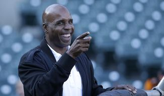 Former baseball player Barry Bonds smiles before a baseball game between the San Francisco Giants and the Chicago Cubs in San Francisco, Wednesday, Aug. 26, 2015. (AP Photo/Jeff Chiu)