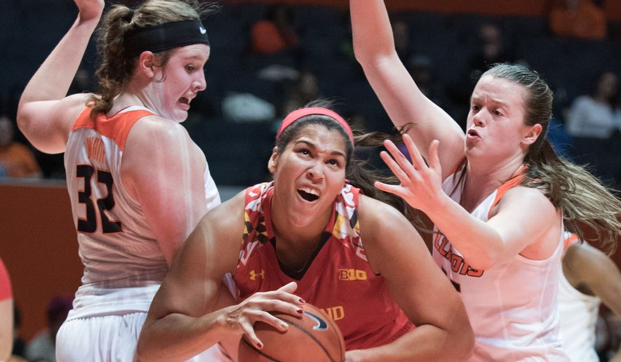Maryland center Brionna Jones, center, tries to get past Illinois center Chatrice White (32) and forward Alex Wittinger (35) during the first half of an NCAA college basketball game in Champaign, Ill., Thursday, Dec. 31, 2015. (AP Photo/Robin Scholz)