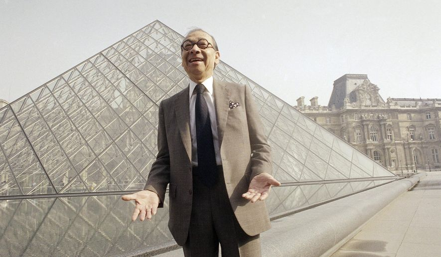 FILE - In this March 29, 1989 file photo, Chinese American architect  I.M. Pei bursts out laughing while posing in front of the Louvre glass pyramid, in the museum's Napoleon Courtyard, prior to its inauguration by French President Francois Mitterrand, in Paris. A home health aide to the 98-year-old renowned architect Pei has been charged with assaulting him inside his New York City home. Pei told police that 28-year-old Eter Nikolaishvili grabbed his right forearm and forcefully twisted it Dec. 13, 2015.  (AP Photo/Pierre Gleizes, File)