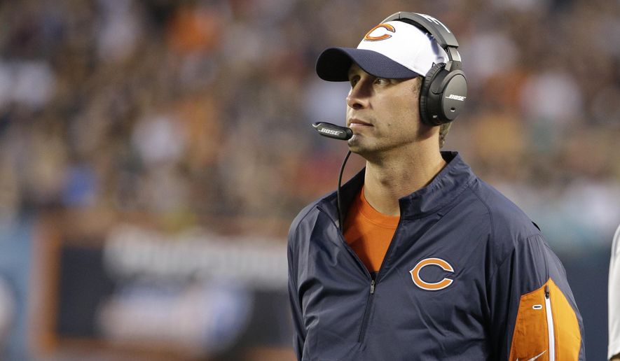 FILE - In this Aug. 13, 2015, file photo, Chicago Bears offensive coordinator Adam Gase during the first half of an NFL preseason football game against the Miami Dolphins in Chicago. Gase and defensive coordinator Vic Fangio could be candidates for head coaching jobs after helping lay a solid foundation in their first year in Chicago. (AP Photo/Nam Y. Huh, File)
