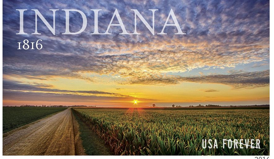 An undated photo provided by the US Postal Service shows a forever stamp to be issued by the The U.S. Postal Service next year honoring then 200th anniversary of Indiana's statehood. The image on the stamp showing a brilliant sunset over a northern Indiana cornfield comes from a photograph by 25-year-old Milford native Michael Matti. (US Postal Service via AP)
