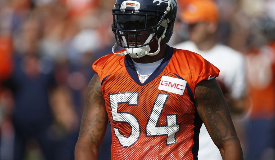 In this photo taken Friday, Aug. 7, 2015, Denver Broncos outside linebacker Brandon Marshall takes a break from drills at the team's NFL football training camp in Englewood, Colo. Marshall, who is the top tackler on the top-ranked defense in the NFL, could use a rest for his sprained ankle but will play against the San Diego Chargers Sunday with an AFC West title on the line and a shot at a first-round bye in the playoffs.  (AP Photo/David Zalubowski)