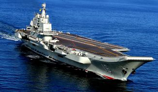 In this Oct. 14, 2012 photo, the Liaoning, China's first aircraft carrier, sails in the sea near Qingdao in eastern China's Shandong province. China's Defense Ministry spokesman Col. Yang Yujun told reporters at a news conference Thursday, Dec. 31, 2015 that China is building a second aircraft carrier, this time entirely with domestic technology. (Chinatopix via AP) CHINA OUT