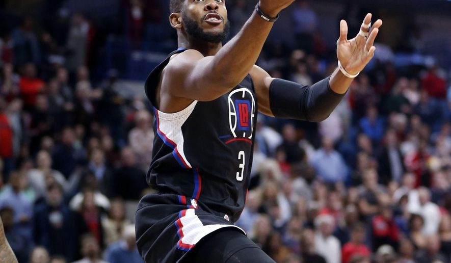 Los Angeles Clippers guard Chris Paul (3) goes to the basket in front of New Orleans Pelicans forward Alonzo Gee (15) in the first half of an NBA basketball game in New Orleans, Thursday, Dec. 31, 2015. (AP Photo/Gerald Herbert)