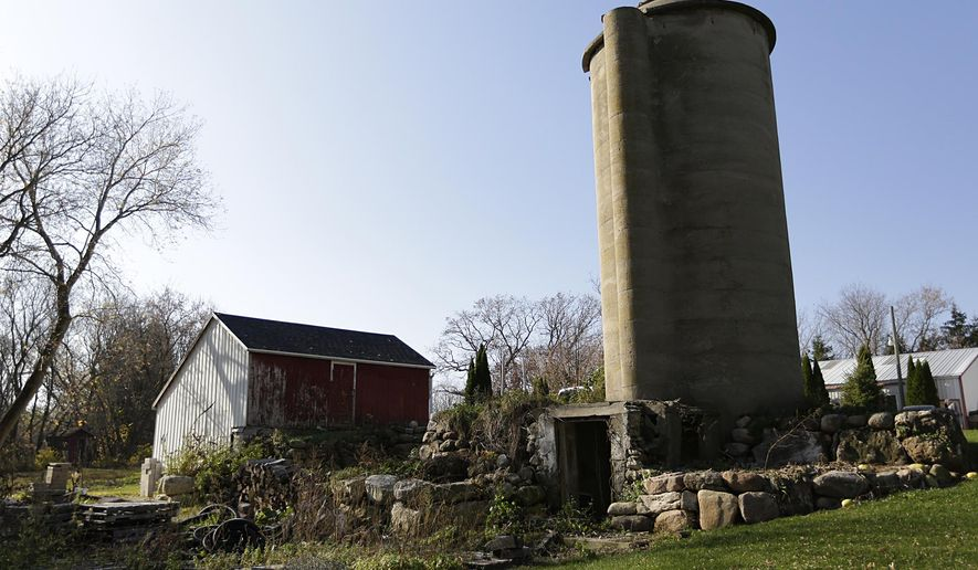 This photo taken on Thursday, Nov. 12, 2015, a stone foundation in Malone, Wis., is all that's left of a barn where a major moonshine operation was during the Depression. (Doug Raflik/The Reporter via AP) NO SALES; MANDATORY CREDIT