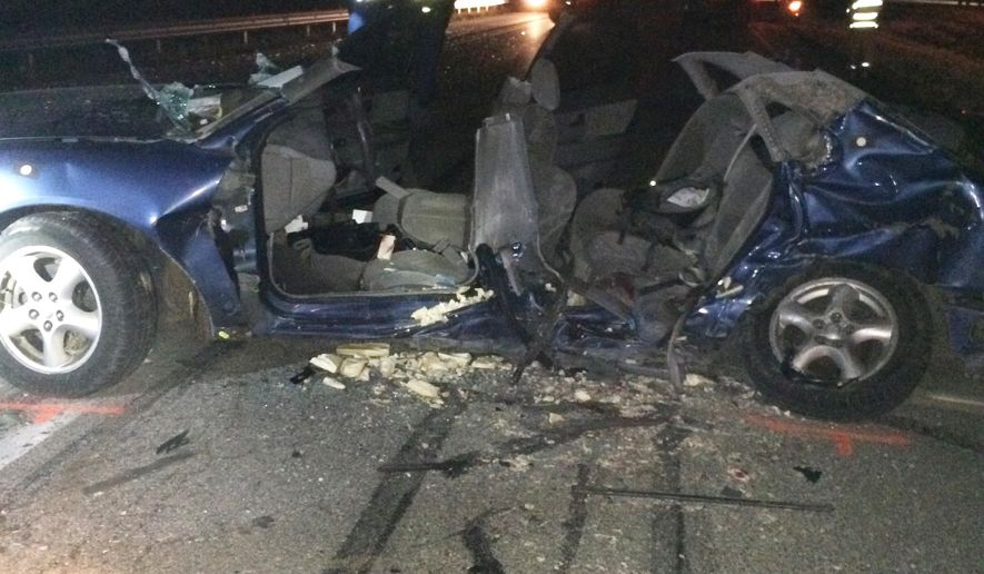 A photo provided by the Indiana State Police shows a Ford Taurus involved in a crash in Waverly, Ind., Wednesday evening that killed four Brownsburg, Ind. teenagers. The four died Wednesday evening when their car crossed a median on a state highway near Indianapolis and struck a minivan, Indiana State Police said. FIve others, including a fifth passenger in the Taurus and a family of four in the minivan, were taken to a hospital for treatment, police said. (Indiana State Police via AP)