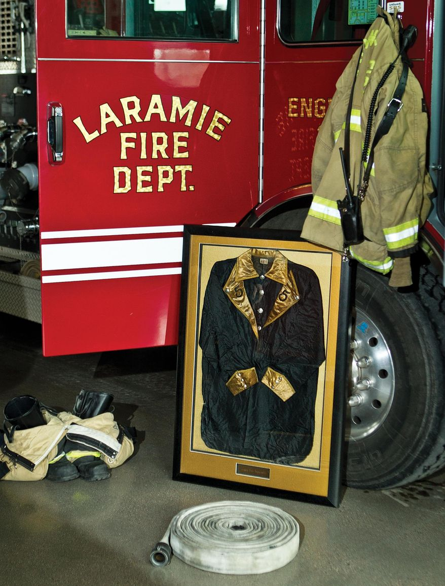 Seen in a Dec. 17, 2015 photo, Laramie Fire Department Station No. 3's museum will be the new home to a Hose Company No. 5 uniform jacket that was recently donated to the department by Vi and Gary Moats, owners of Aphrodite's Emporium in downtown Laramie.  (Jeremy Martin/Laramie Boomerang via AP)