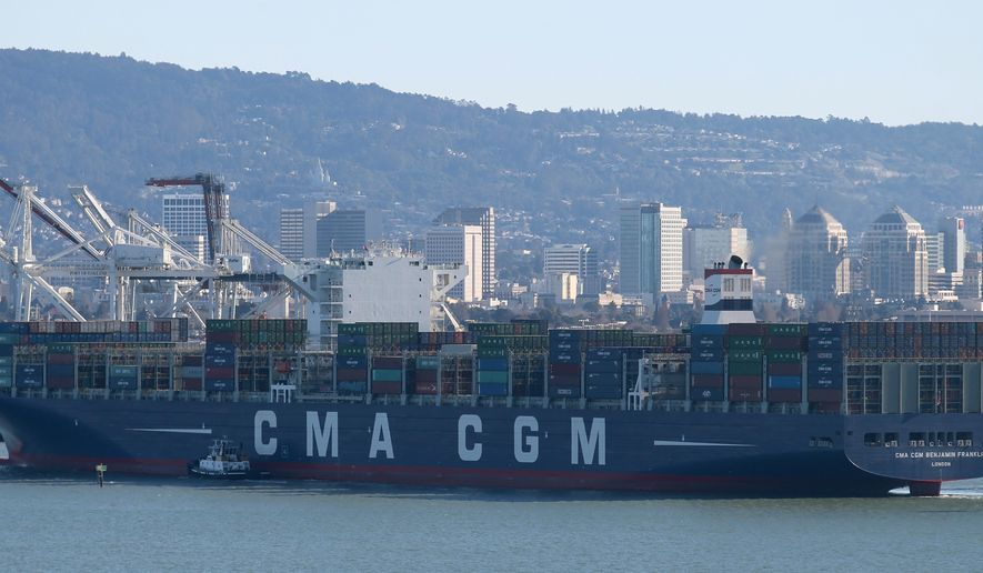 The 1,300-foot-long Benjamin Franklin cargo ship passes Yerba Buena Island as it heads to the Port of Oakland on Thursday, Dec. 31, 2015. The container ship is the largest ever to visit the United States and is 10th largest in the world. It was launched from a Chinese shipyard last month and is making a stop in Oakland on its maiden voyage. (Jane Tyska/Oakland Tribune via AP) MANDATORY CREDIT