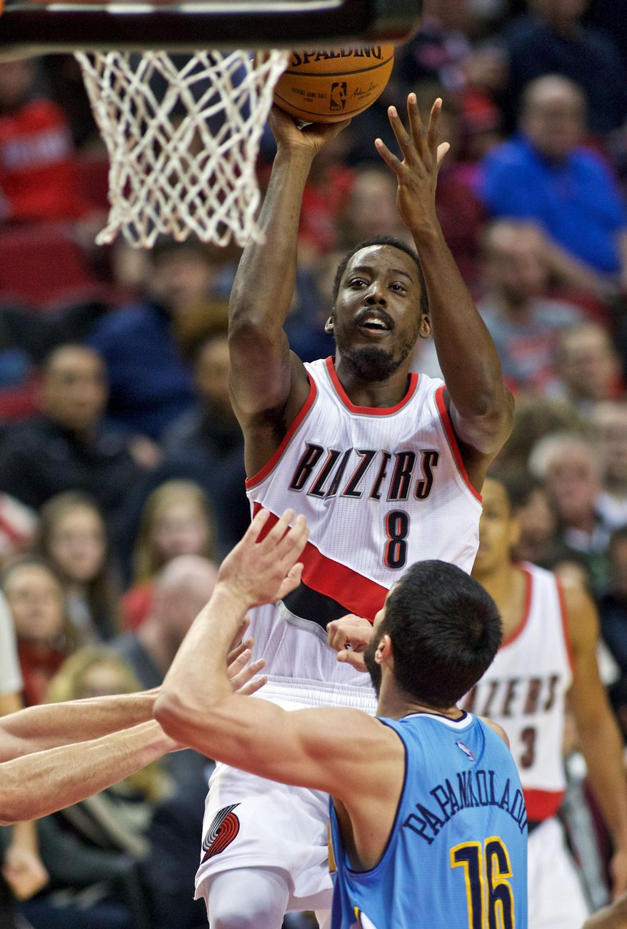 Portland Trail Blazers forward Al-Farouq Aminu shoots over Denver Nuggets forward Kostas Papanikolaou during the second half of an NBA basketball game in Portland, Ore., Wednesday, Dec. 30, 2015. (AP Photo/Craig Mitchelldyer)