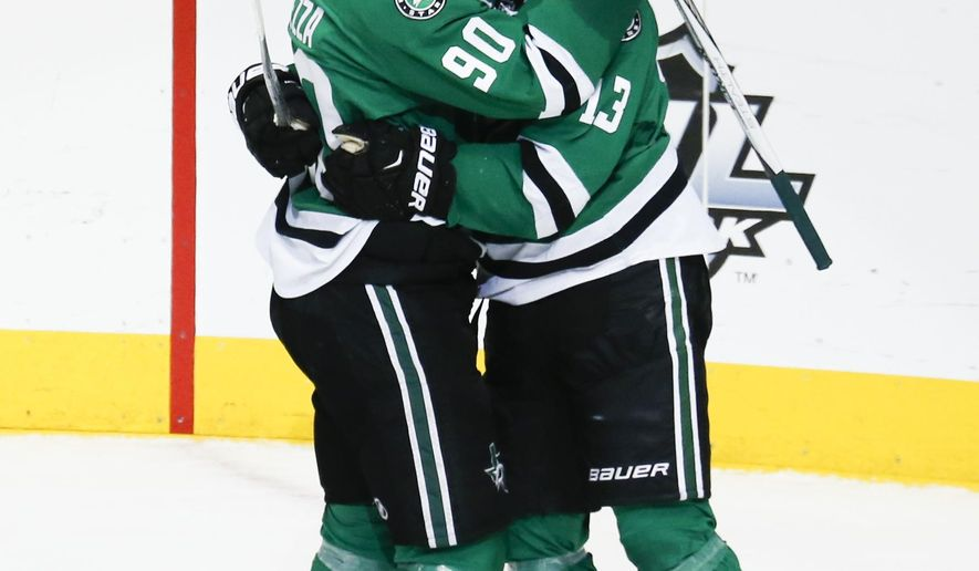 Dallas Stars center Mattias Janmark (13) is congratulated by teammate Jason Spezza following his score during the second period of an NHL hockey game, Thursday, Dec. 31, 2015, in Dallas. (AP Photo/Jim Cowsert)