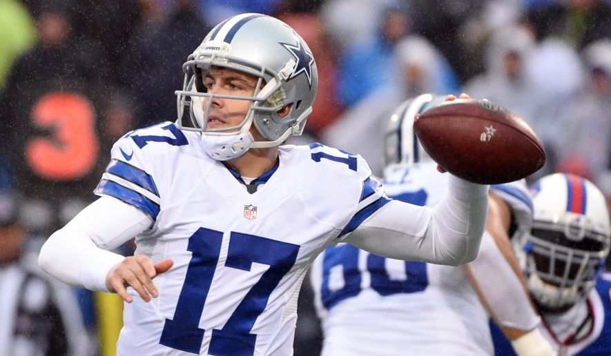 FILE - In this Dec. 27, 2015, file photo, Dallas Cowboys quarterback Kellen Moore throws against the Buffalo Bills during the second half of an NFL football game in Orchard Park, N.Y. The Cowboys take on the Washington Redskins on Sunday. (AP Photo/Gary Wiepert, File)