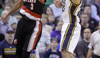Utah Jazz guard Raul Neto, right, right passes the ball as Portland Trail Blazers guard C.J. McCollum (3) defends during the second quarter of an NBA basketball game Thursday, Dec. 31, 2015, in Salt Lake City. (AP Photo/Rick Bowmer)