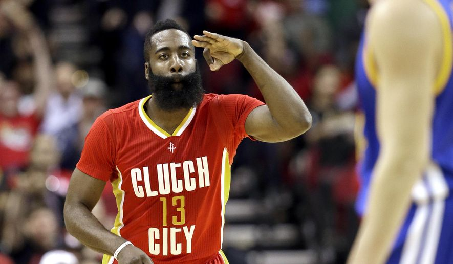 Houston Rockets' James Harden (13) gestures toward Golden State Warriors' Klay Thompson, right, after making a 3-point basket during the first half of an NBA basketball game Thursday, Dec. 31, 2015, in Houston. (AP Photo/David J. Phillip)