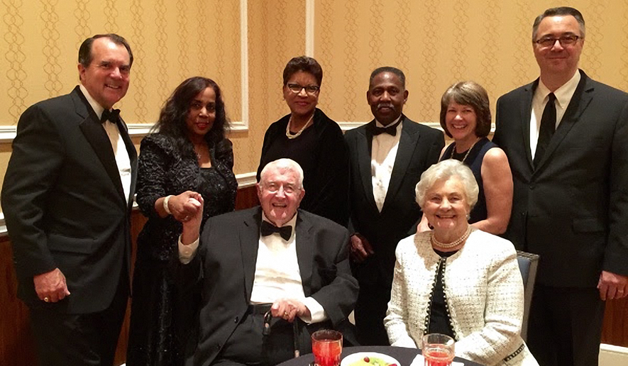 Dick Bott shakes hands with Lynne Jackson, great, great-granddaughter of Dred Scott, amid family and friends. Photo courtesy of Bott Radio Network.