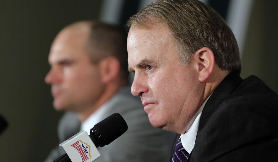 TCU head coach Gary Patterson, right, and Oregon head coach Mark Helfrich, left, attend a news conference for the Alamo Bowl NCAA college football game, Friday, Jan. 1, 2016, in San Antonio. The two teams meet on Saturday. (AP Photo/Eric Gay)