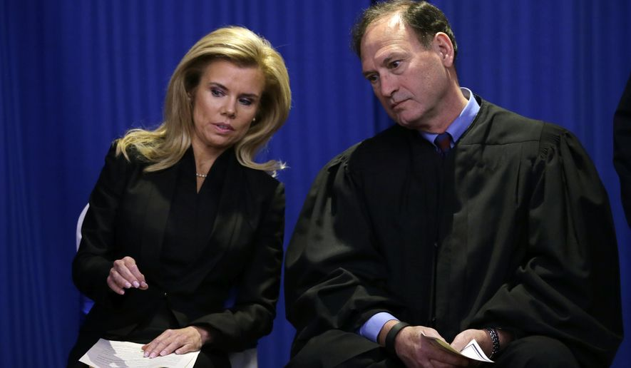Hamilton Township Mayor Kelly A. Yaede, left, and U.S. Supreme Court Justice Samuel Alito talk together before he administered the oath of office to her Friday, Jan. 1, 2016, in Hamilton Township, N.J. Yaede won her first full, four-year term last November. She has led the Mercer County community since November 2012, when she took over for former Mayor John Bencivengo after he resigned following his conviction on corruption charges. Alito was born in Trenton and raised in Hamilton. (AP Photo/Mel Evans)