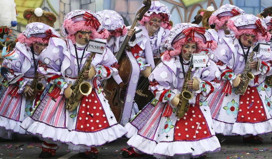 Members of the Polish American String Band perform during the 116th annual Mummers Parade in Philadelphia on Friday, Jan. 1, 2016. Outrageously costumed Mummers strutted their stuff Friday at the city's annual New Year's Day parade, a colorful celebration that features string bands, comic brigades, elaborate floats and plenty of feathers and sequins. (AP Photo/Joseph Kaczmarek)