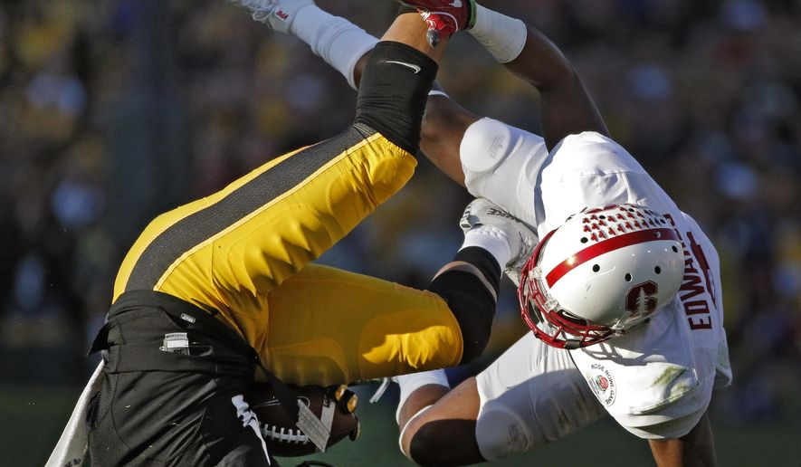 Stanford safety Ben Edwards, right, tackles Iowa wide receiver Tevaun Smith during the first half of the Rose Bowl NCAA college football game, Friday, Jan. 1, 2016, in Pasadena, Calif. (AP Photo/Jae C. Hong)