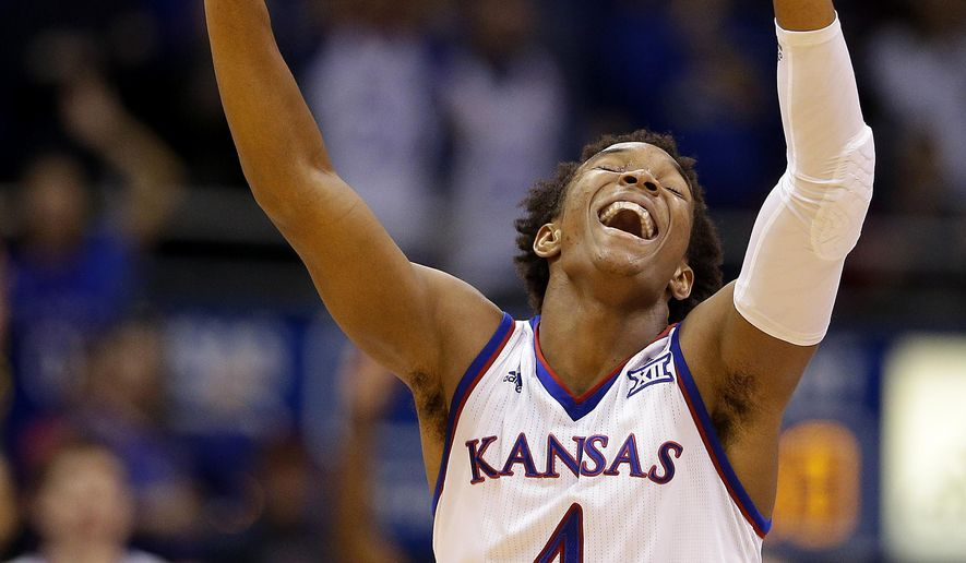Kansas' Devonte' Graham celebrates after a teammates basket during the second half of an NCAA college basketball game against UC Irvine, Tuesday, Dec. 29, 2015, in Lawrence, Kan. Kansas won 78-53. (AP Photo/Charlie Riedel)
