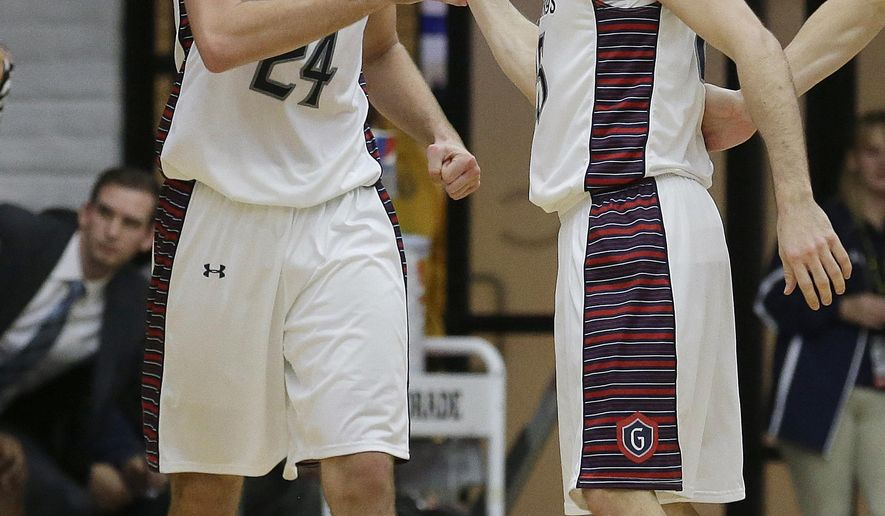 Saint Mary's (Calif.) forward Calvin Hermanson (24) and guard Joe Rahon celebrate during the second half of an NCAA college basketball game against BYU in Moraga, Calif., Thursday, Dec. 31, 2015. Saint Mary's won 85-74. (AP Photo/Jeff Chiu)