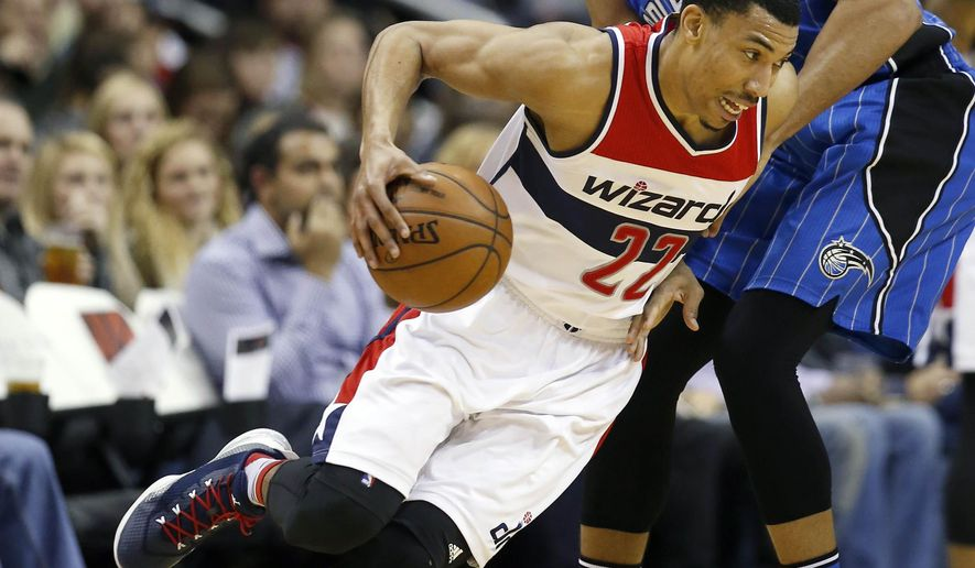 Washington Wizards forward Otto Porter Jr. (22) drives against Orlando Magic forward Tobias Harris (12) in the first half of an NBA basketball game, Friday, Jan. 1, 2016, in Washington. (AP Photo/Alex Brandon)