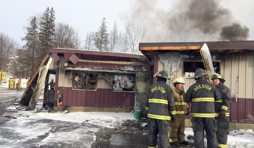 Firefighters continue to work the scene following a fire at at The B & B Bowl & Restaurant in Preston, Minn., on New Year's Day, Friday, Jan. 1, 2016.  No injuries were reported and the cause of the fire is under investigation.  (Elizabeth Nida Obert /The Rochester Post-Bulletin via AP) MANDATORY CREDIT