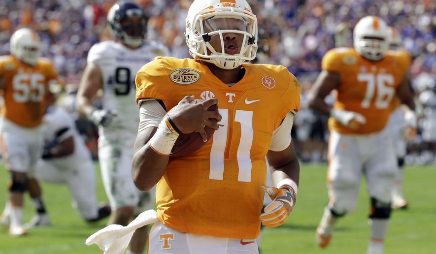 Tennessee quarterback Joshua Dobbs (11) runs 14-yards for a touchdown against Northwestern during the first quarter of the Outback Bowl NCAA college football game Friday, Jan. 1, 2016, in Tampa, Fla. (AP Photo/Chris O'Meara)