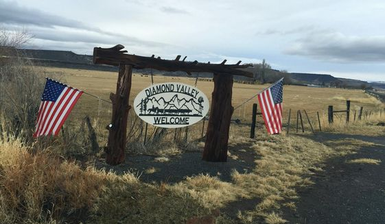 A private sign welcomes visitors to the Diamond Valley, part of the Harney Basin in southeast Oregon, in mid-December 2015. The valley is home to large cattle ranches that rely on both private and public land for grazing. The prosecution of Dwight and Steven Hammond for burning public lands has brought fresh focus to the debate over how federal land is managed. (Les Zaitz/The Oregonian via AP)