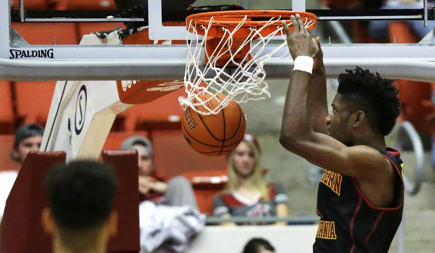 Southern California forward Chimezie Metu dunks against Washington State in the first half of an NCAA college basketball game, Friday, Jan. 1, 2016, in Pullman, Wash. (AP Photo/Ted S. Warren)