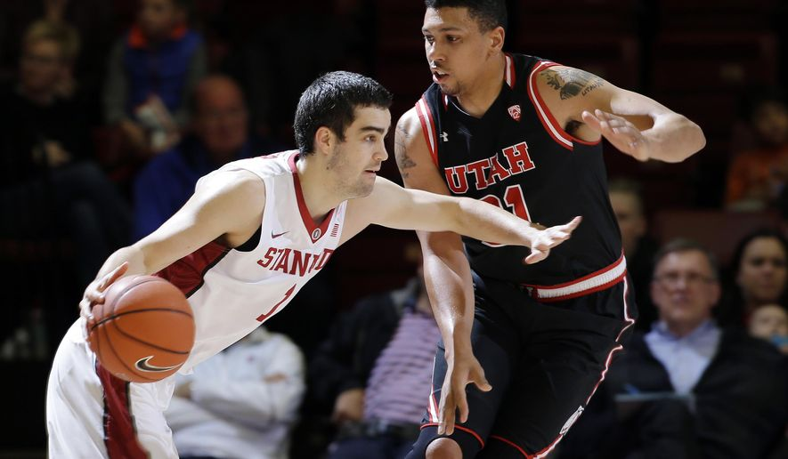 Stanford guard Christian Sanders, left, is defended by Utah forward Jordan Loveridge during the first half of an NCAA college basketball game Friday, Jan. 1, 2016, in Stanford, Calif. (AP Photo/Marcio Jose Sanchez)