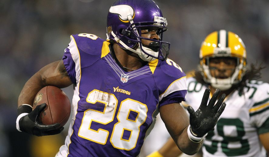 FILE - In this Dec. 30, 2012, file photo, Minnesota Vikings running back Adrian Peterson, left, runs from Green Bay Packers cornerback Tramon Williams during the first half of an NFL football game in Minneapolis. This weekend won't be the first time a Green Bay-Minnesota game directly decided the division title. That happened in 2004, too, and many other meaningful, memorable games between the border-state rivals have been held over the last 55 years. (AP Photo/Genevieve Ross, File)