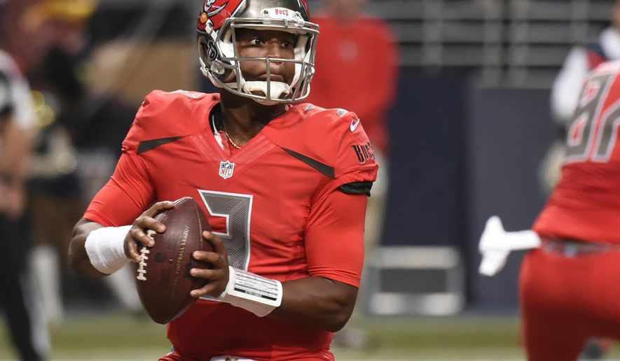 FILE - In this Dec. 17, 2015, file photo, Tampa Bay Buccaneers quarterback Jameis Winston drops back to pass during the second quarter of an NFL football game against the St. Louis Rams in St. Louis. Winston will finish his rookie season doing something that Marcus Mariota simply could not: Playing in all 16 regular-season games. (AP Photo/L.G. Patterson, File)