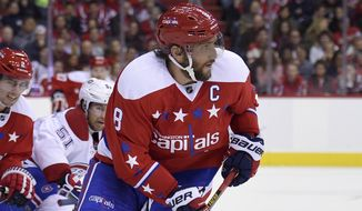 Washington Capitals left wing Alex Ovechkin (8), of Russia, skates with the puck against the Montreal Canadiens during the second period of an NHL hockey game, Saturday, Dec. 26, 2015, in Washington. (AP Photo/Nick Wass)