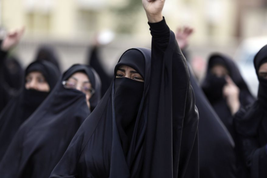 Bahraini protesters chant anti-government slogans during a march in support of Saudi Shiite Sheikh Nimr al-Nimr, in Daih, a suburb of Manama, Bahrain, Saturday, Jan. 2, 2016. Saudi Arabia announced Saturday it had executed 47 prisoners convicted of terrorism charges, including al Qaida detainees and al-Nimr, who rallied protests against the Saudi government. The execution of al-Nimr is expected to deepen discontent among Saudi Arabia's Shiite minority and heighten sectarian tensions across the region. (AP Photo/Hasan Jamali)