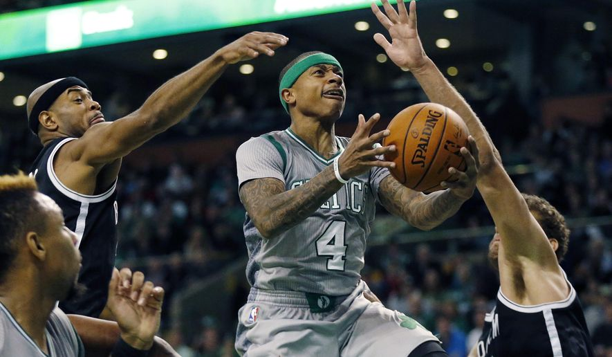 Boston Celtics' Isaiah Thomas (4) goes up to shoot between Brooklyn Nets' Jarrett Jack, left, and Brook Lopez, right, during the second quarter of an NBA basketball game in Boston, Saturday, Jan. 2, 2016. (AP Photo/Michael Dwyer)