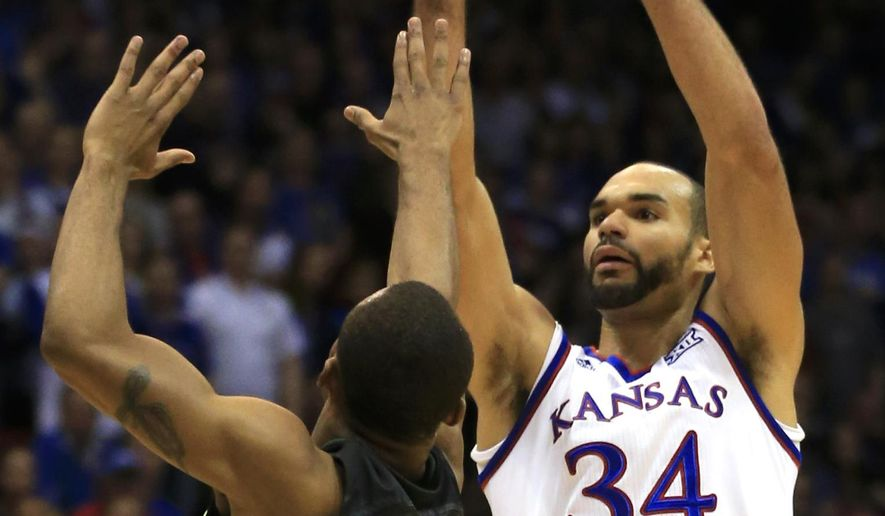 Kansas forward Perry Ellis (34) shoots over Baylor guard Lester Medford (11) during the first half of an NCAA college basketball game in Lawrence, Kan., Saturday, Jan. 2, 2016. (AP Photo/Orlin Wagner)