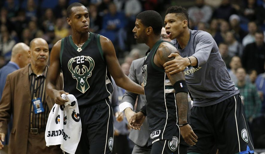 Milwaukee Bucks forward Giannis Antetokounmpo, right, and guard Khris Middleton, left, restrain guard O.J. Mayo, center, as he goes toward a referee after being assessed a second technical foul during the first half of an NBA basketball game against the Minnesota Timberwolves in Minneapolis, Saturday, Jan. 2, 2016.  (AP Photo/Ann Heisenfelt)