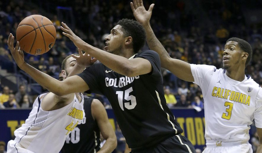 Colorado guard Dominique Collier (15) shoots between California guard Tyrone Wallace (3) and center Kameron Rooks during the first half of an NCAA college basketball game in Berkeley, Calif., Friday, Jan. 1, 2016. (AP Photo/Jeff Chiu)