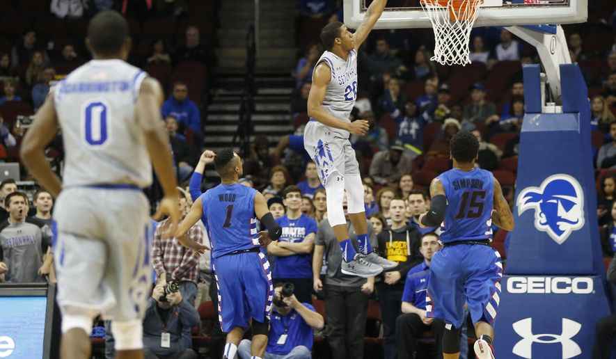 Seton Hall forward Desi Rodriguez, center, dunks against DePaul during the first half of an NCAA college basketball game, Saturday, Jan. 2, 2016, in Newark, N.J. (AP Photo/Julio Cortez)