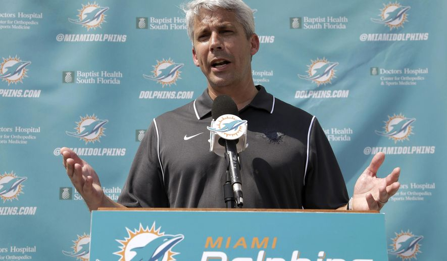 FILE - In this May 23, 2014, file photo, Miami Dolphins general manager Dennis Hickey speaks to reporters after a one-day rookie NFL football minicamp in Davie, Fla. Hickey's departure from the Dolphins after two years in Miami was announced Saturday, Jan. 2, 2016, on the eve of the season finale against New England. (AP Photo/Wilfredo Lee, File)