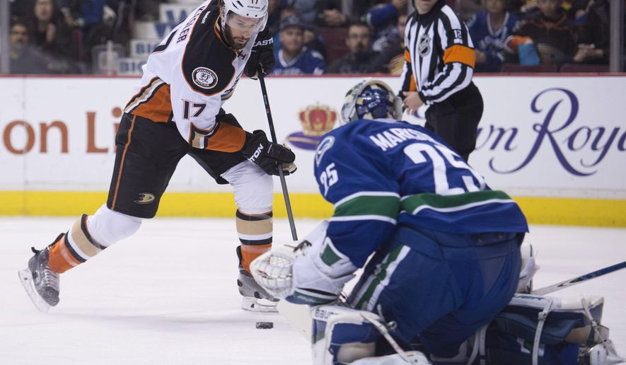 Anaheim Ducks center Ryan Kesler (17) tries to get a shot past Vancouver Canucks goalie Jacob Markstrom (25) during the first period of an NHL hockey game in Vancouver, British Columbia, Friday, Jan. 1, 2016.  (Jonathan Hayward/The Canadian Press via AP) MANDATORY CREDIT