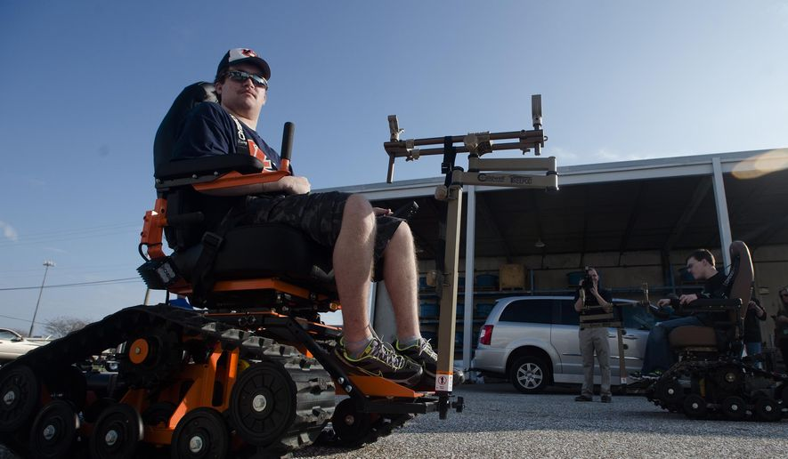 ADVANCE FOR THE WEEKEND OF JAN. 2 - In this Tuesday, Dec. 29, 2015 photo, Ryan Evans rides his new Trac Wheel Chairs in Montgomery, Ala. The chairs will allow someone who is wheelchair bound the ability to explore the outdoors. The donations are being managed through Iron Men Outdoor Ministries and were donated by Daniel Ricketts. (Albert Cesare/The Montgomery Advertiser via AP)  NO SALES; MANDATORY CREDIT