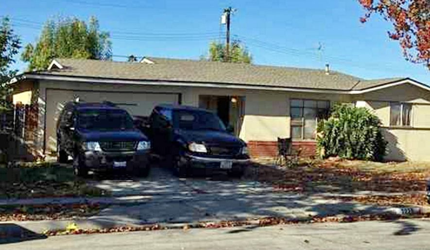 Vehicles are parked outside a home where Los Angeles County authorities say a man shot and killed his wife and two others on New Year's Eve before his son wrestled the gun away and fatally shot him Friday, Jan. 1, 2016, in Rowland Heights, Calif. The Sheriff's Department said Friday that the other two victims killed were the son's girlfriend who also lives at the house in Rowland Heights and a man who was visiting. (Sandra Molina/Los Angeles Newspaper Group via AP) MAGS OUT; NO SALES; MANDATORY CREDIT