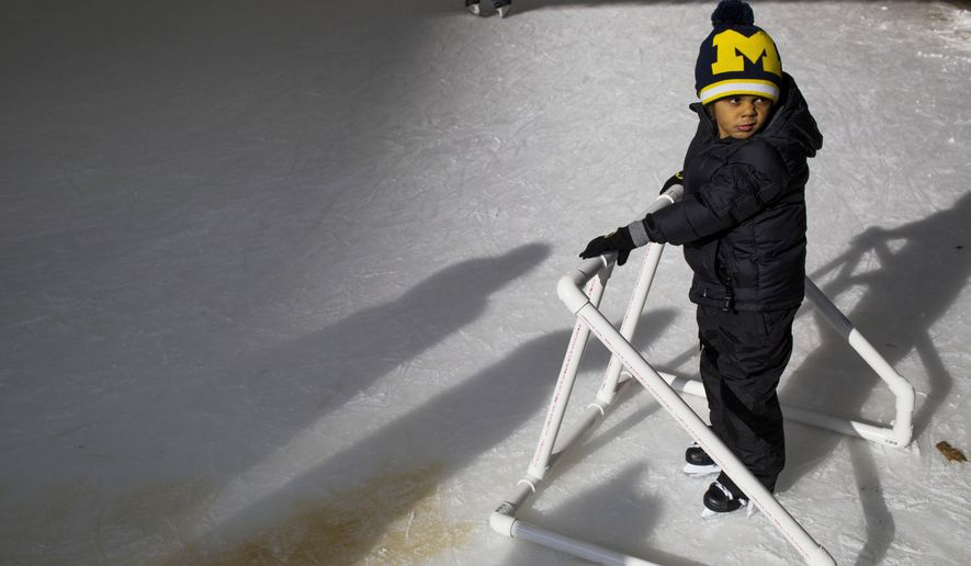 Kallen Robertson, 5, of Grand Blanc, Mich., takes his first steps on the ice as families and friends skate at University of Michigan-Flint's grand re-opening of their ice skating rink in Flint, Mich., Saturday, Jan. 2, 2016, in Flint, Mich. (Danny Miller/The Flint Journal-MLive.com via AP) MANDATORY CREDIT