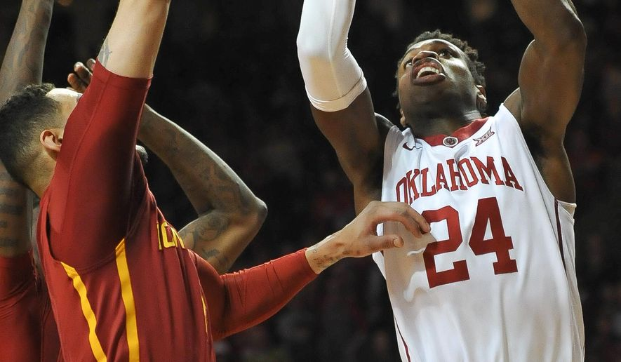 Oklahoma guard Buddy Hield, right, shoots over Iowa State forward Abdel Nader (2) during the first half of an NCAA college basketball game in Norman, Okla., Saturday, Jan. 2, 2016. (AP Photo/Kyle Phillips)